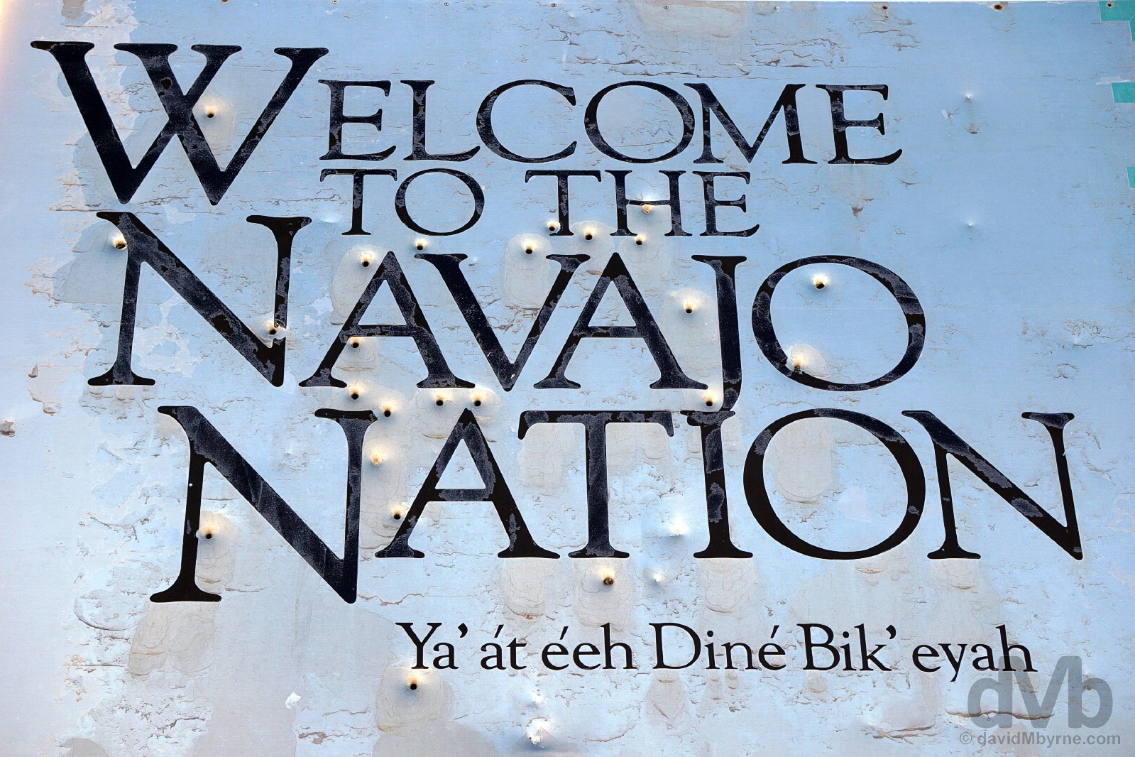 A bullet hole-infused 'Welcome To The Navajo Nation' sign near the Four Corners Monument off US 160 on the New Mexico/Arizona state line. September 10, 2016,