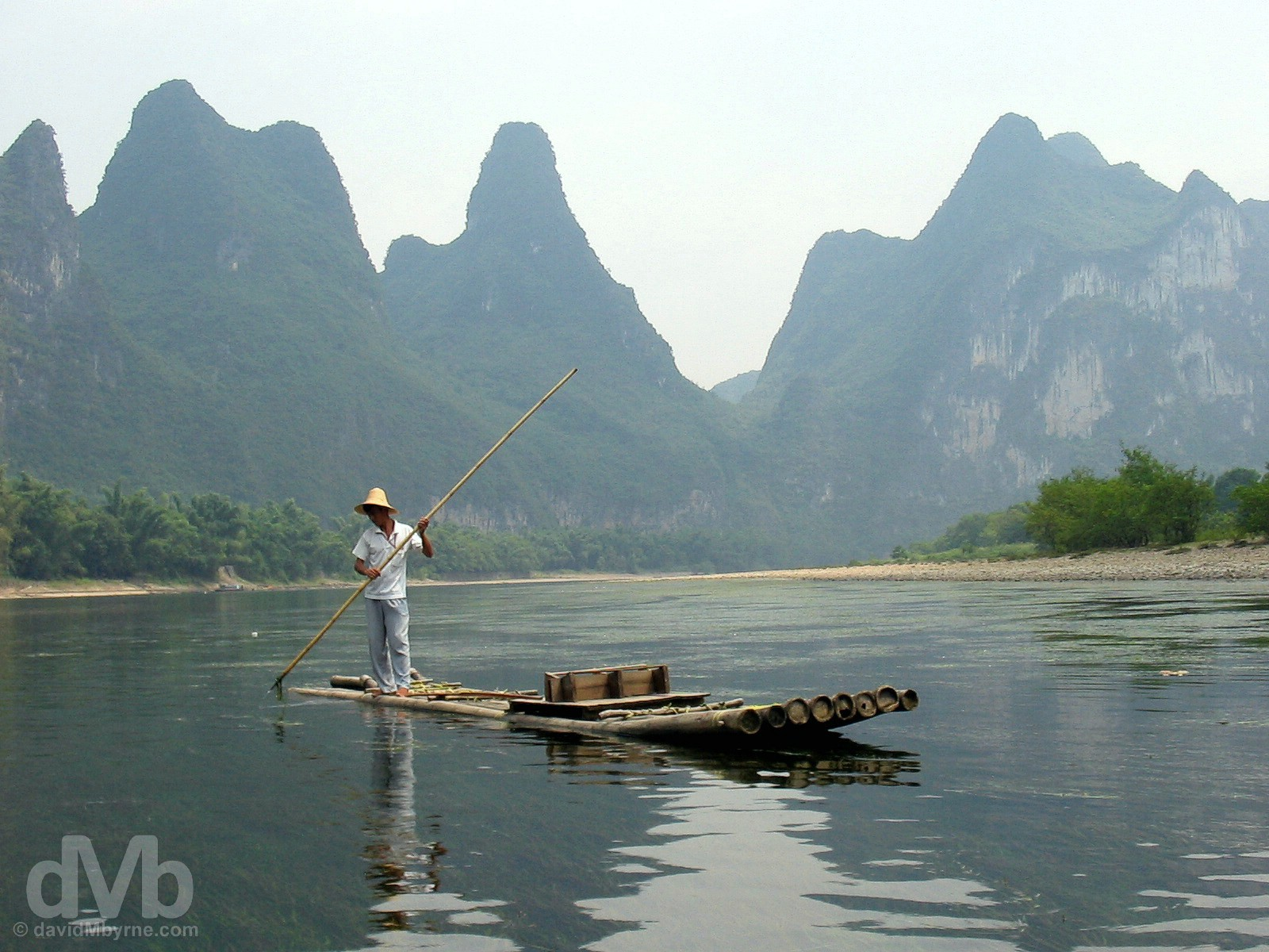 Navigating the scenic Li River outside Yangshou in Guangxi Province, Southern China. September 13, 2004.