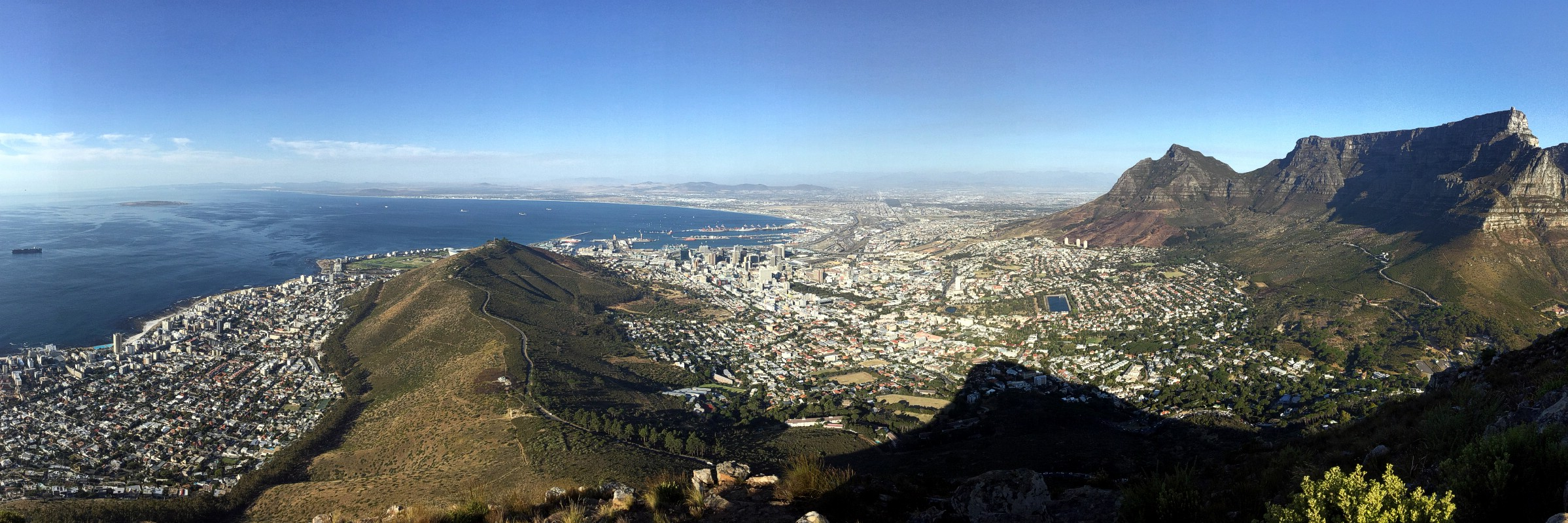 A panorama of (L-R) Table Bay, Signal Hill, Cape Town & Table Mountain as seen from the top of Lion's Head, Western Cape, South Africa. February 22, 2017.
