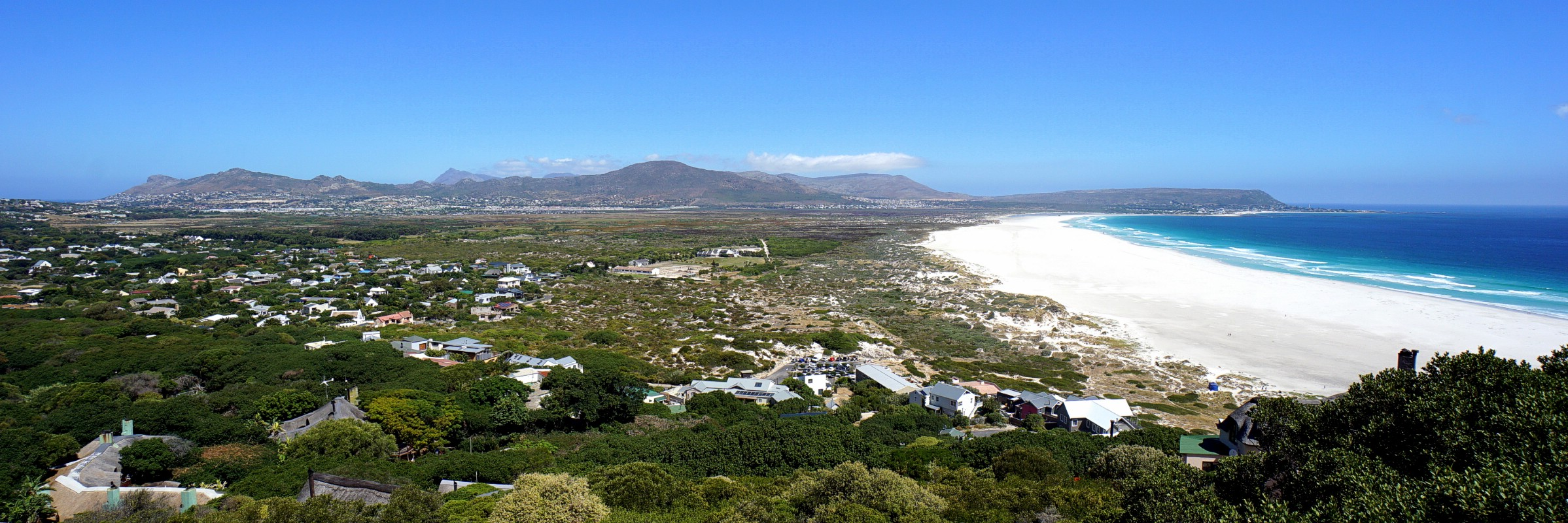A panorama over Noordhoek Beach & Chapman's Peak as seen from the end of Chapman's Peak Drive, Cape Peninsula, Western Cape, South Africa. February 17, 2017.