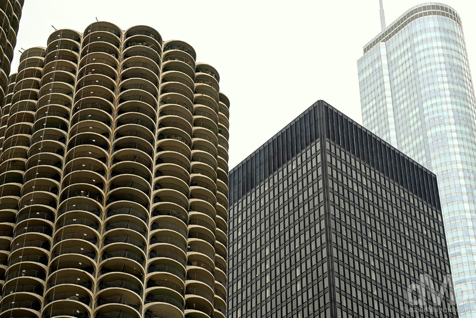 The towers of (L-R) Marina City, IBM Plaza & Trump International Hotel overlooking the Chicago River in downtown Chicago, Illinois, USA. October 2, 2016.