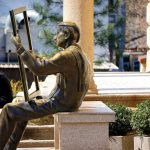 A statue of a painter fronting the Art Gallery in Old Town Plovdiv, Bulgaria. March 30, 2015.