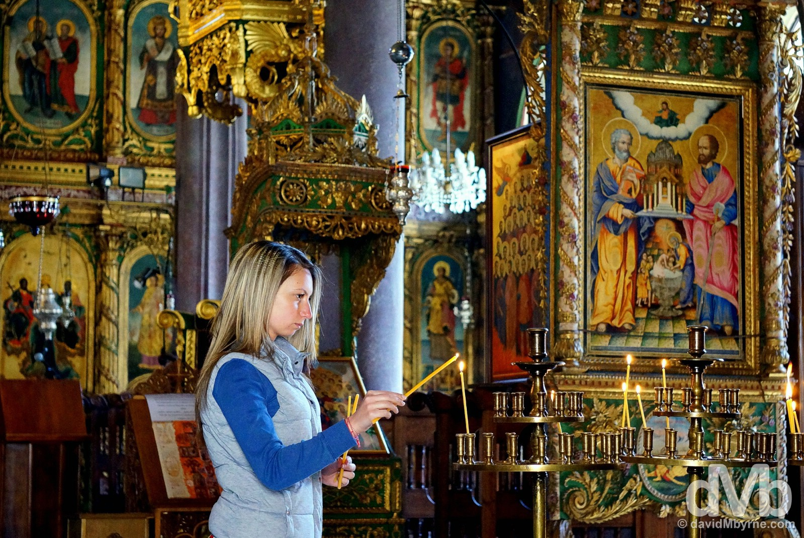 Lighting a candle in the Church of St Constantine and Helena in Old Town Plovdiv, Bulgaria. March 30, 2015.