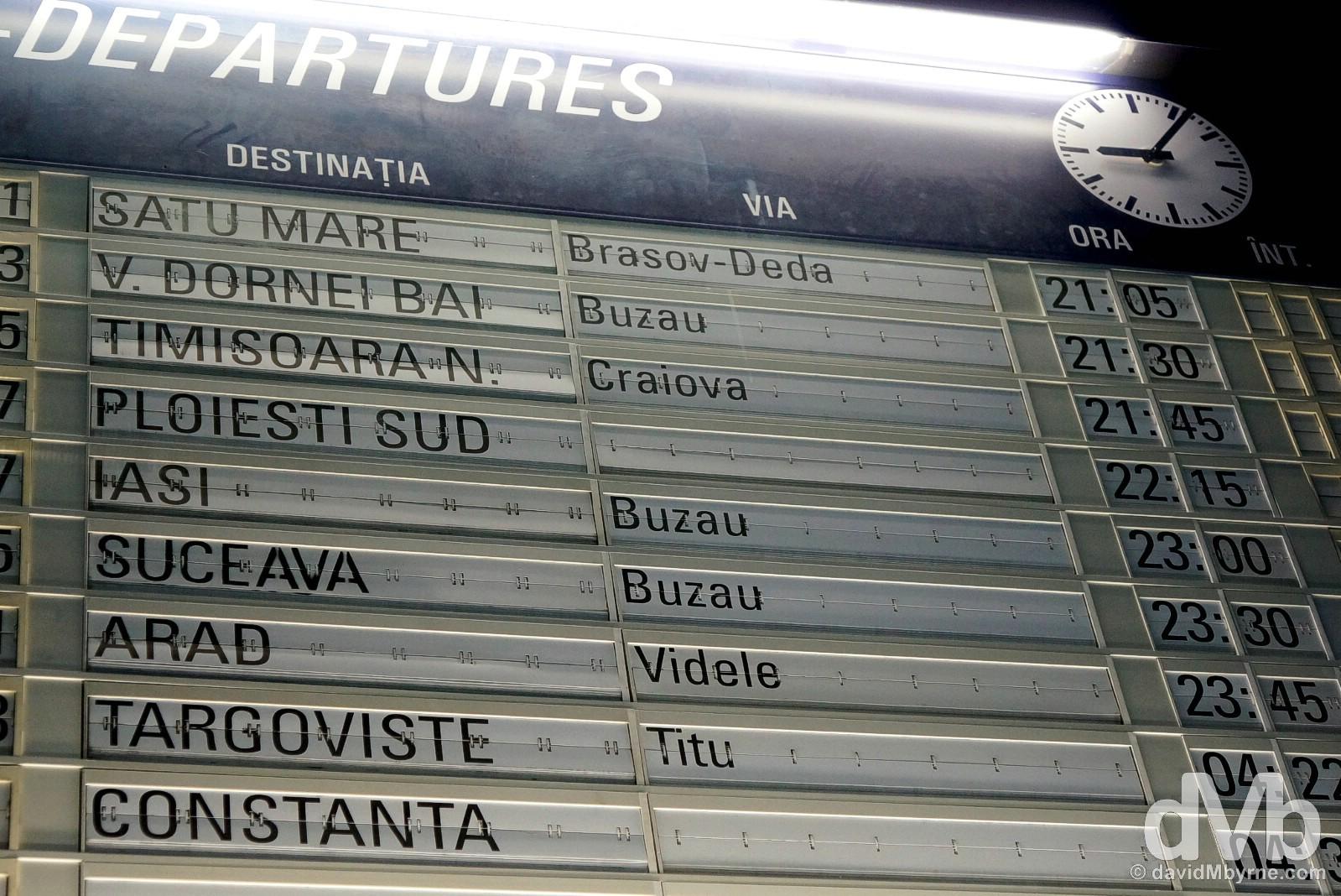 Night train to Belgrade, Serbia. The departures board in Gara de Nord, Bucharest, Romania. April 2, 2015.