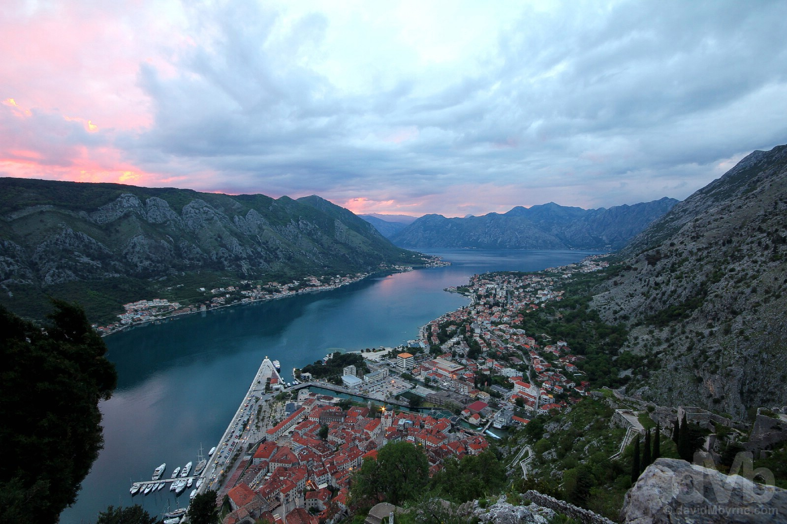 Sunset on an overcast day as seen from Castle St, John, the highest point of the fortifications overlooking Kotor & Kotor Bay, Montenegro. April 19, 2017.