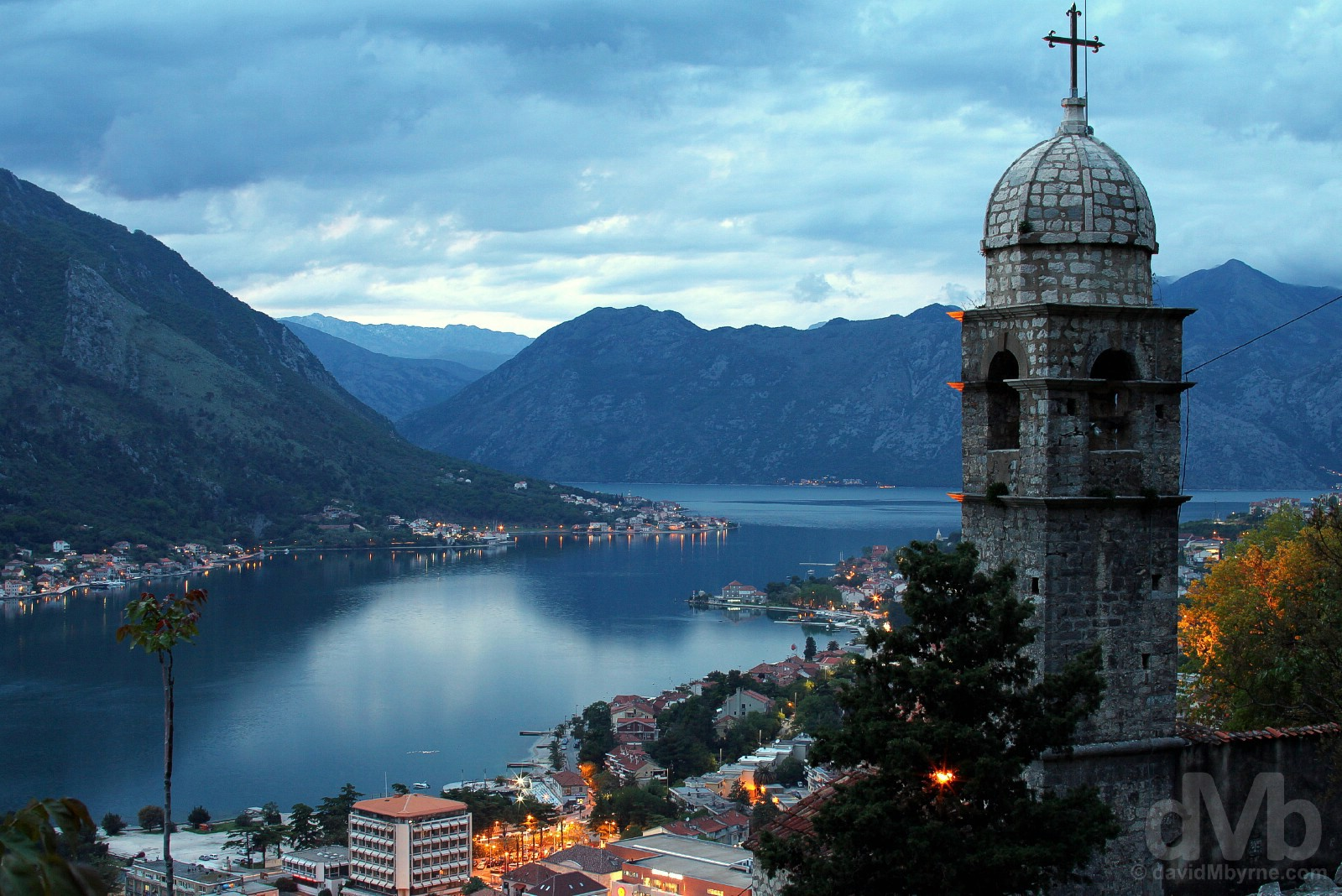 Kotor & the spire of the 1518 Church of Our Leady of Remedy at dusk on the fortress walls overlooking Kotor Bay, Montenegro. April 19, 2017.