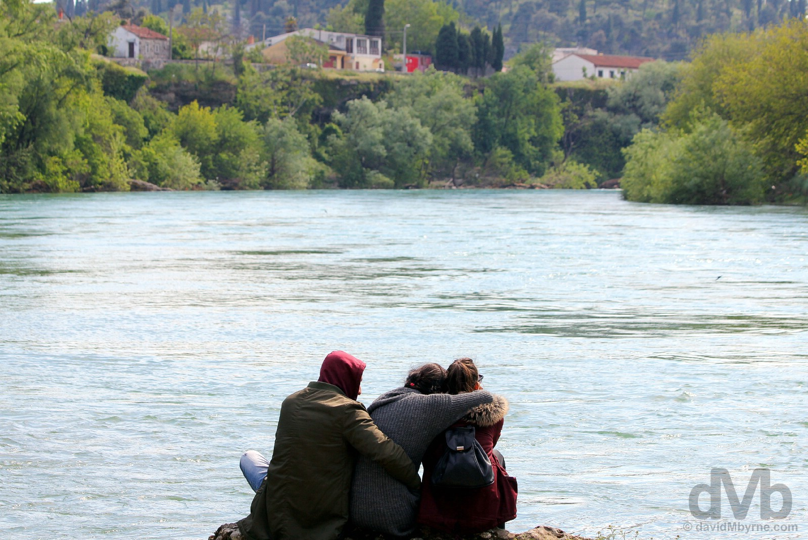 Friends. On the banks of the fast-flowing Moraca River in Podgorica, Montenegro. April 21, 2017.