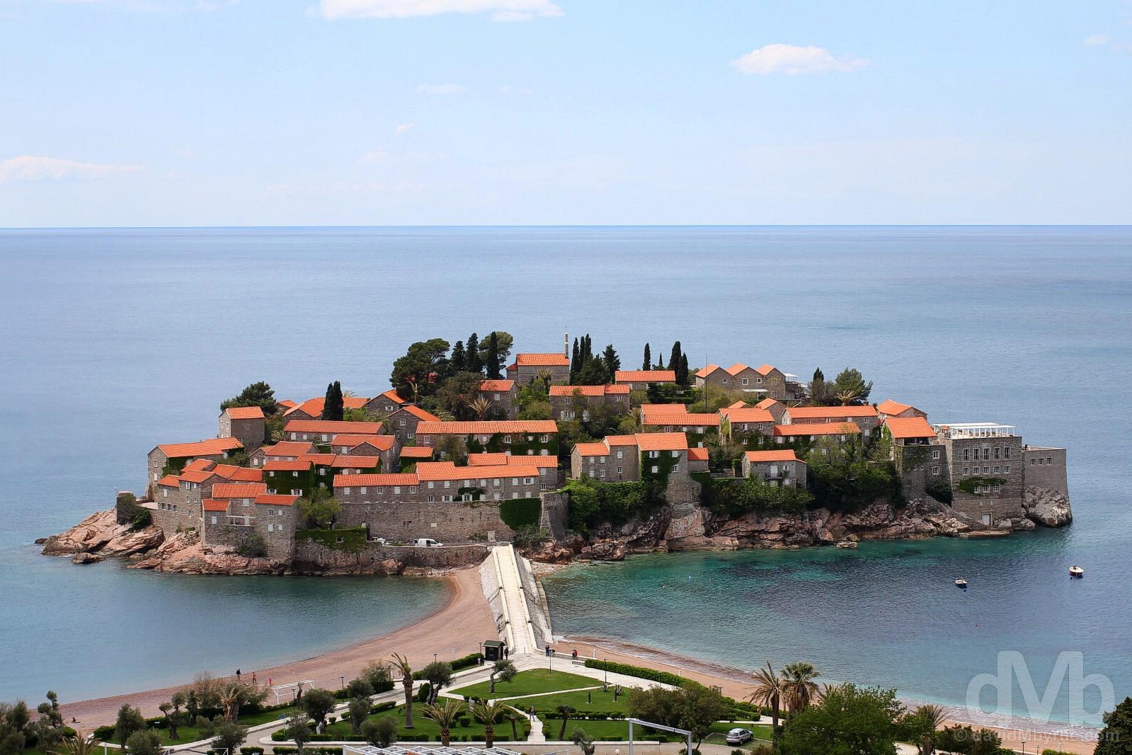 The uber-plush 5-star fortress resort island of Sveti Stefan as seen from the coastal-hugging E80, Budvanska Rivijera, Montenegro. April 21, 2017.