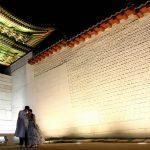 By the towering walls and Gwanghwamun Gate of Gyeongbokgung Palace, Seoul, South Korea. July 26, 2017.