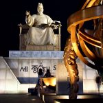 KING SEJONG || Revered King Sejong was the 4th king of the Joseon Dynasty (1397-1450, reigning from 1418-1450) and was responsible for some of the most brilliant achievements in the history of Korea, including the creation of Hangeul (the Korean alphabet) and great advancements in the areas of science, culture, art and politics. This 9.5-metre-high bronze statue of the king was erected in the center of Sejongno's Gwanghawmun Square on Hangeul Day (October 9) in 2009. Sitting with a gentle smile on his face and a book in his hand, the rear of the statue is the access point for the underground The Story of King Sejong Exhibition Hall, a 3,200? museum detailing the king's accomplishments. Fronting the statue lie a celestial globe, a rain gauge and a sundial, all of which the good king is said to have invented himself during his reign. The King Sejong Statue in Gwanghawmun Square, Seoul, South Korea. July 26, 2017.