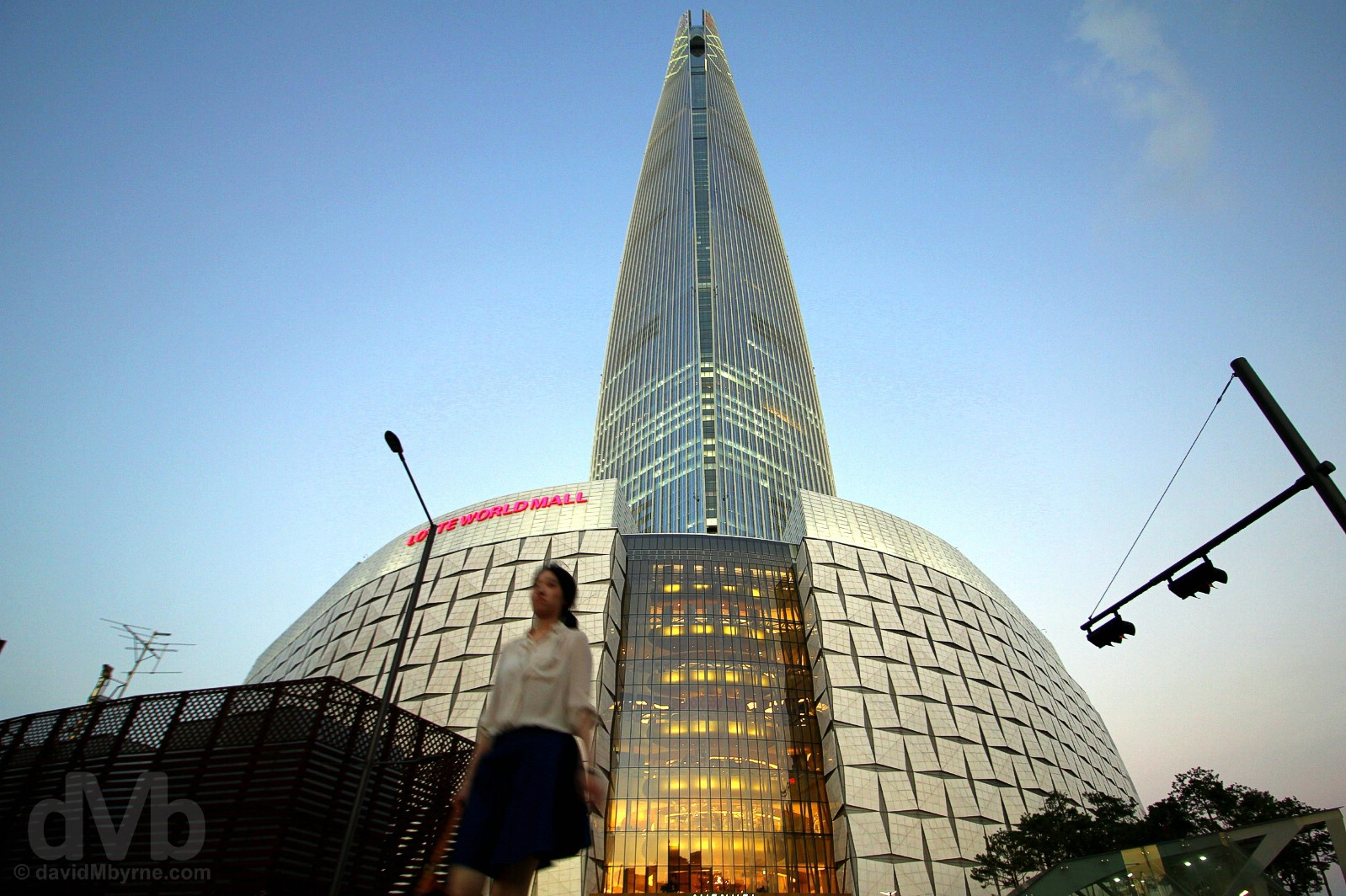 Dusk at the base of Lotte World Tower in Jamsil, Seoul, South Korea. July 25, 2017.