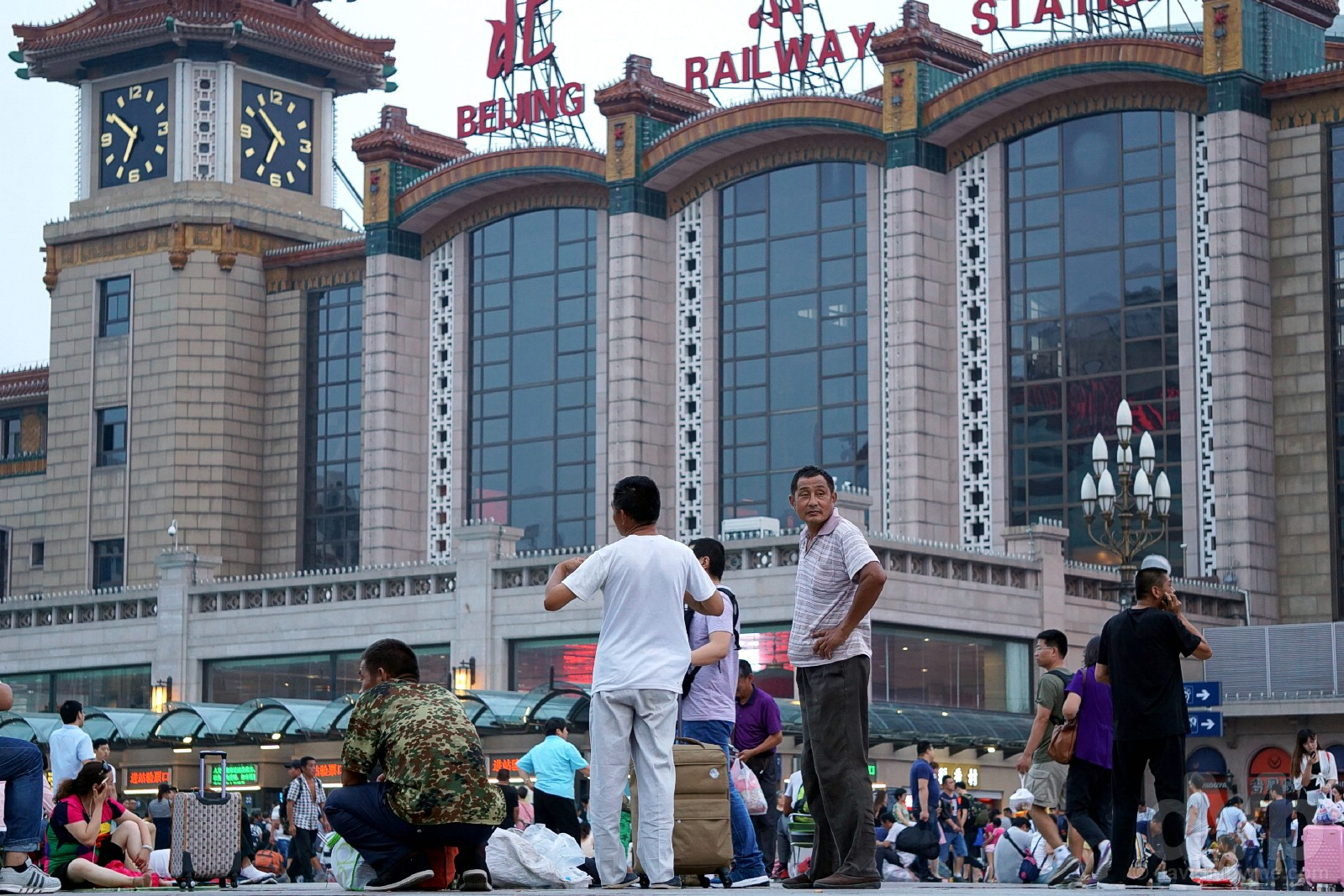 On the expansive concourse fronting Beijing Train Station in Beijing, China. August 10, 2017.