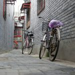 Bicycles resting in a hutong, an old residential lane, in the Qianmen district of Being, China. August 11, 2017.