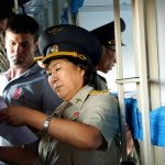 Document checks on board the daily 95 train from Sinuiji to Pyongyang. Sinuiju Train Station, northern North Korea. August 14, 2017.