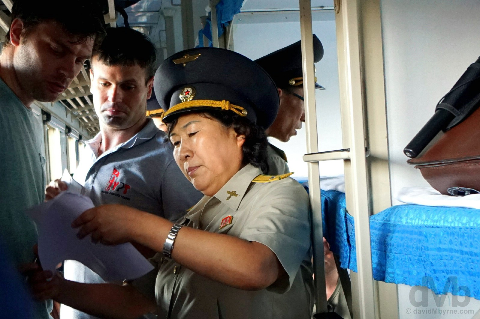 Document checks on board the daily 95 train from Dandong, China to Pyongyang. Sinuiju, North Korea. August 14, 2017.
