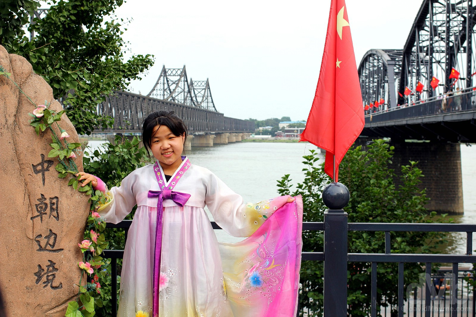 Posing in a traditional Korean hanbok by the edge of the Yalu River in Dandong, Liaoning province, China. August 13, 2017.