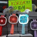 LED fashion fans. Yeoksam metro station, Seoul, South Korea. August 5, 2017.
