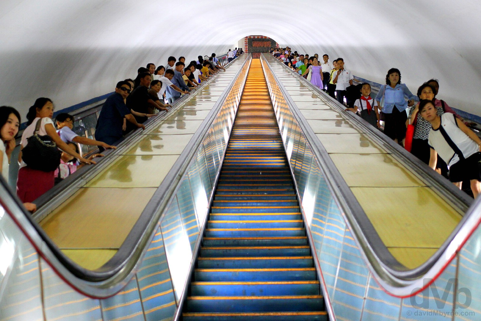 Entering the Pyongyang Metro, the world's deepest. Pyongyang, North Korea. August 15, 2017.
