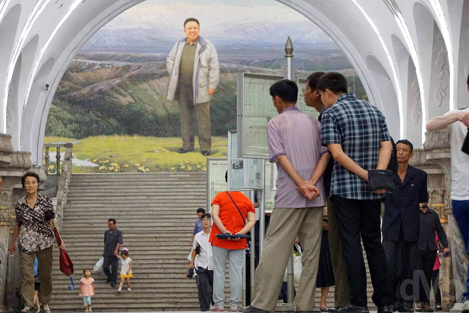 Getting the news on the platform of the Pyongyang Metro, the world's deepest. Pyongyang, North Korea. August 15, 2017.