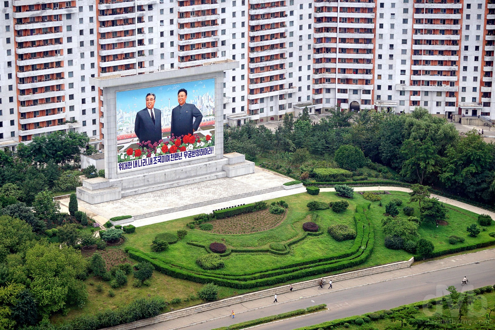 A massive Kim Il-sung & Kim Jong-il mural in the Mangyongdae District of Pyongyang, North Korea. August 16, 2017.