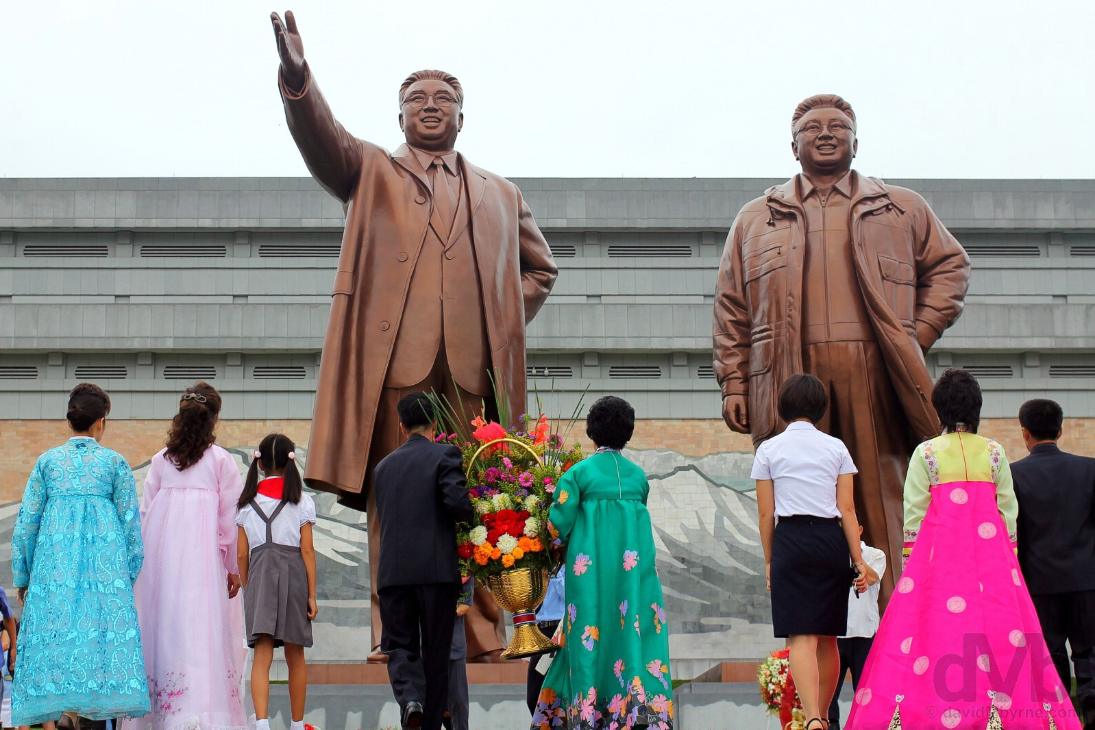 Flower offerings to Kim Il-sung, The Great Leader (left) & Kim Jong-il, The Dear Leader (right), at the Grand Monument on Mansu Hill, Pyongyang, North Korea. August 15, 2017.