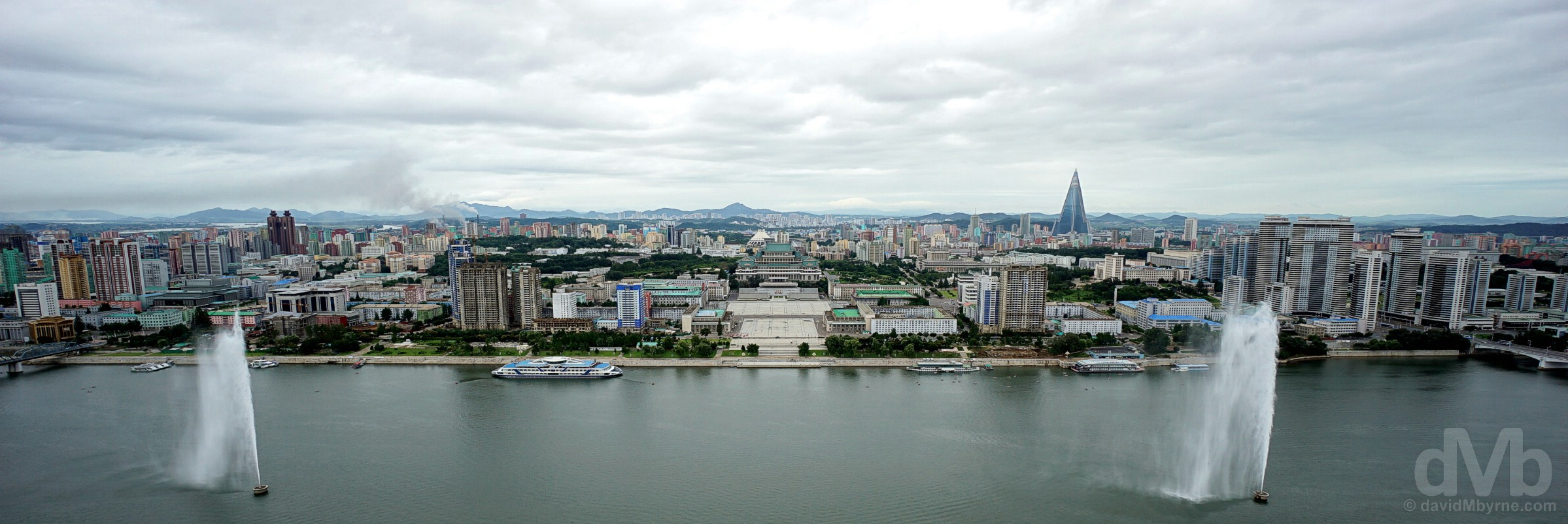 A panorama looking across the Taedong River towards Kim Il-sung Square & western Pyongyang as seen from the top of the Juche Tower, Pyongyang, North Korea. August 15, 2017.