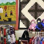 Amish quilts & dolls. Farmers Market, Bird in Hand, Lancaster County, Pennsylvania, USA. September 30, 2017.