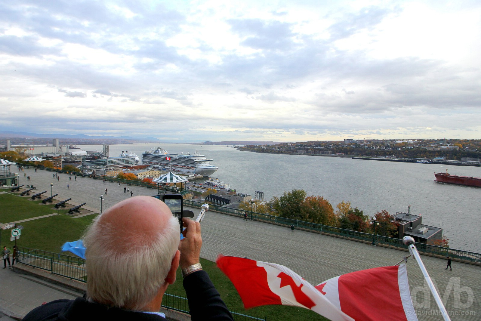 Photographing the St Lawrence River from the balcony of the Hotel Terrasse Dufferin, Quebec City, Quebec, Canada. October 24, 2017.
